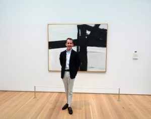 Kevin is in front of a Franz Kline painting - one of his favorite artists. Kevin has two paintings done in the style of Franz Kline in his New York apartment.