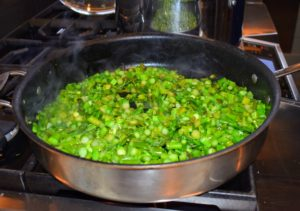 Here is a pan of peas and chopped asparagus on the stove - our quiche is so very healthy. This will be added to the spinach next - spinach that is also from my garden.