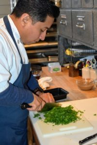 Chef Pierre's sous chef for the day, German, chopped the herbs for our dishes. The herbs were just cut from the garden minutes before this photo was taken.