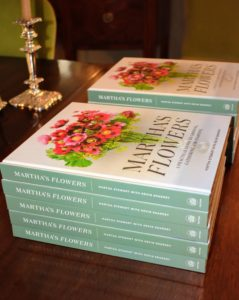 "We placed copies of ""Martha's Flowers"" on the table for guests who didn't already have a copy."