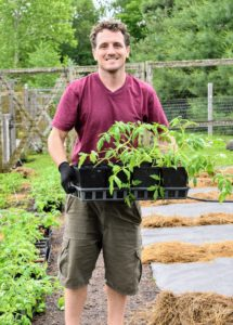 Here is Ryan bringing out one of the many trays of tomato plants - these plants were all started from seed in my greenhouse.