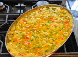 Eggs were added to our fritatta vegetables and then poured into a large copper pan before placing in a 425-degree Fahrenheit oven.