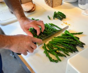 Chef Pierre cuts more asparagus to top our corn salad.