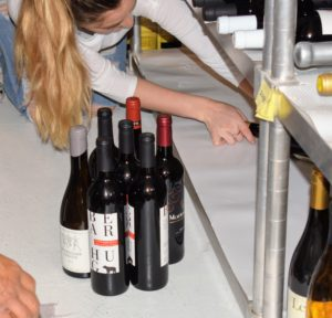 Another wine organizing tip is to consider the size of the bottles collected - magnum bottles hold double at 1.5 liters - these giant bottles need more space. Shqipe puts bigger bottles on a bottom shelf.