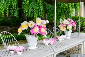 My longtime housekeeper, Laura Acuna, made gorgeous peony arrangements to line the table on the terrace parterre.
