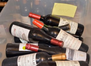 This year, all the uncategorized bottles were placed in bins according to vintage year.