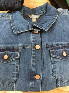 Here is the denim jean jacket in a medium indigo. It has a classic fold over collar, long sleeves and two functional pockets.