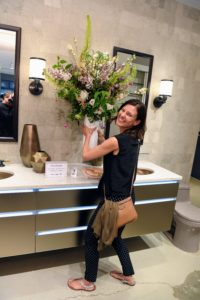 This lucky guest even won a flower arrangement! (Photo by Sean Sime)