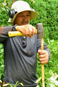 Chhiring uses the same bamboo uprights cut to about four feet and hammers them into the ground several inches deep.