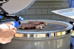 The grill was set to 500-degrees Fahrenheit as Pat starts putting the steaks on the grill grate. These steaks are simply seasoned with salt and pepper.