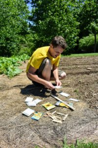 Before planting, Ryan determines which seeds will be planted where depending on height and size of blooms.