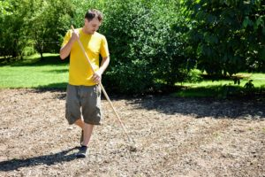 And finally, Ryan goes over the bed with a rake to make it look neat and tidy before giving the seeds a good watering.