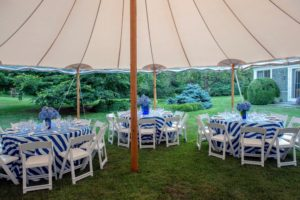 Outside, the event space was decorated in bold blue and white - so cheerful and bright. (Photo by Daniel Gonzalez for Business of Home)