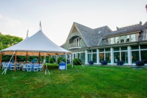 Tables were set up out back under the shade of these large tents. (Photo by Daniel Gonzalez for Business of Home)