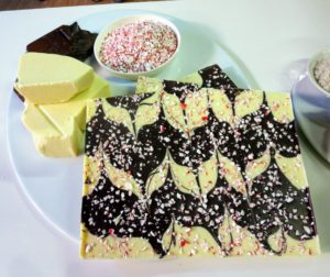 The peppermint bark is made with white chocolate, dark Belgium chocolate and crushed pieces of candy cane.