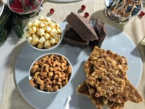 The brittle includes fresh cashews and kettle corn, which is a sweet-and-salty variety of popcorn that's typically mixed or seasoned with salt and oil.