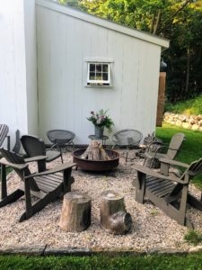 Just outside the barn is a comfortable fire pit area set on a bed of pea gravel.