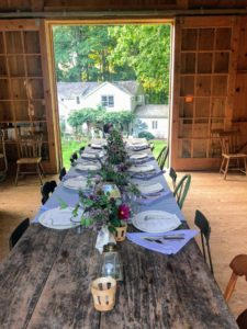 The barn includes a long 14-foot antique wooden farm table that seats 16 - the mismatched chairs add lots of charm to this handsome entertaining space. There were nine of us for dinner.