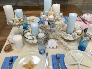 Here is a table setting with the blue and white colored pillar candles. My round pillars come in sets of three with a remote control.