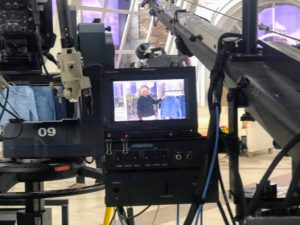 There are always multiple cameras whenever we shoot at QVC. Each camera is equipped with a monitor. The long arm on the right is called a jib, which captures images from above.