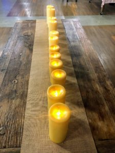 We placed an entire row of honeycomb pillar candles down this long table - candles make such a wonderful centerpiece for any occasion.
