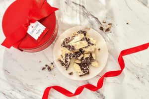 Each tin contains two pounds of this scrumptious treat - and then tied with a festive red bow and gift tag.