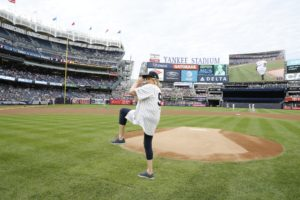 I lift my left leg, bending at the knee. (Photo by: New York Yankees)