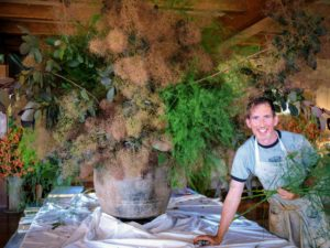And here is Kevin with a giant Cotinus arrangement in the Living Hall. The pink billowy hairs of smokebush are mixed with the feathery asparagus ferns also from my Bedford garden.