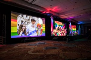 Large monitors were provided for supplemental videos and a view of the stage. (Photo by Rachel Stevenson/OUTCOAST Photography)