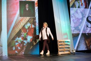 Here I am walking out onto the stage. I have always believed that creativity and entrepreneurship are the keys to business success. (Photo by Rachel Stevenson/OUTCOAST Photography)