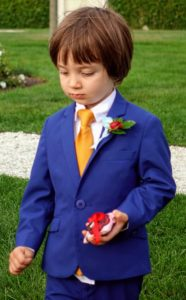 Here is young ring bearer, Atreus, carefully walking down the aisle.