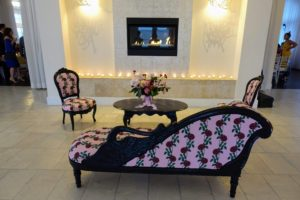 Inside, custom wedding textile upholstered furniture displayed more of the rose themed pattern.