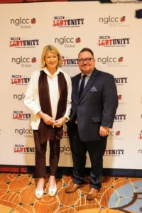 "At large press-filled events like these, there is always time built in for photos in front of what is called a ""step and repeat banner"". Here I am with Justin Nelson, Co-Founder of the NGLCC."