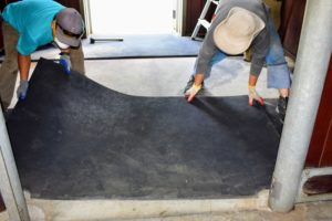 Each mat is returned to its original place. Here, Dawa and Phurba carefully line up the mat seams.