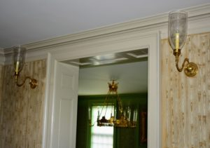 Outside the Green Parlor, I have large single sconces. A sconce may be a traditional torch, candle or gas light, or a modern electric light source affixed in the same way.