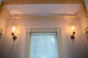 Sconce height is generally three-fourths of the distance up the wall as measured from the floor to the ceiling.