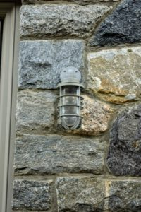 The same style is also used around the stable buildings. They provide good, safe lighting and look very handsome against the stone exterior.