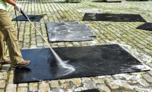 Dolma power washes every corner of every mat. These mats are thick, non-porous and made of 100-percent recycled rubber. They are very important – the flat, non-slip, shock-absorbent surface provides traction, and ease of movement for my horses.