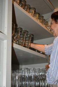 I store lots of glasses and dishes in my servery. This entire cabinet is filled with all kinds of glasses that I use for entertaining.