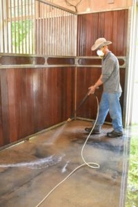Meanwhile, Dawa continues inside and power washes the stall floors.