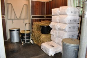 The other side is stocked with hay and wood shavings.