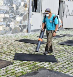 The mats are also dried with a leaf blower and then left under the sun to dry even more.