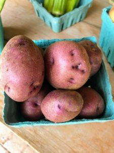 And here is a box of potatoes. Triple Chick Farm grows the most lush vegetables and fruits, and all their produce is organic and chemical free.
