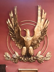 Here's a brass eagle wall piece from Ian McKelvey Antiques in South Windham, Connecticut, a shop specializing in antiquities, art, and furniture.
