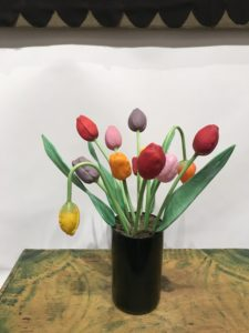 Recognize these? I also have a set. They're German glass tulips from the early 1920s. The set includes red, pink, purple and yellow tulips, all with green stems ranging from eight to 12-inches tall. They're quite rare.