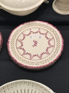 Here is one of a set of 12 English antique creamware plates by Wedgewood from 1872 - a rare pattern with red feathered edges.