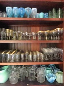 Also in the kitchen, I have large built in shelves that hold my expansive collection of glasses.