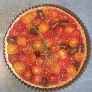 On another day, Chef Molly made a beautiful roasted garlic and tomato tart. The pate brisée flaky crust is spread with a layer of roasted garlic, which we brought up from my Bedford garden. The tomatoes are sprinkled with fresh thyme, salt and pepper - so pretty.
