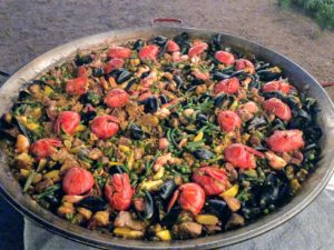 I have two of these 36-inch paella pans - they're perfect for feeding this large group.