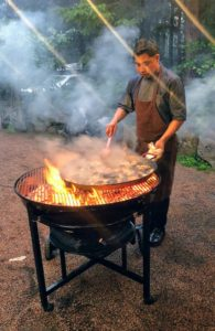 Here is Chef Aron stirring the rice with the seafood, chicken, pork and vegetables. The round grill ensures even heating during the cooking process. Unfortunately, just before dinner began, it started to pour, so everything had to be moved indoors to my dining room - it was a big scramble.